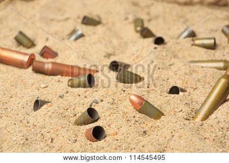 cartridge cases on the sand.