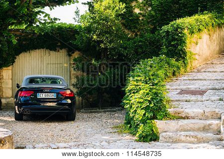 Black convertible car audi a5 parked at beautiful house in Frenc