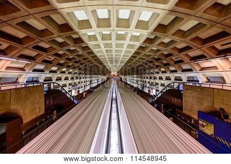 WASHINGTON, D.C. - APRIL 10, 2015: Trains and passengers in a Metro Station. Opened in 1976, the Washington Metro is now the second-busiest rapid transit system in the U.S.
