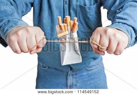 Human hands breaking the pack of cigarettes