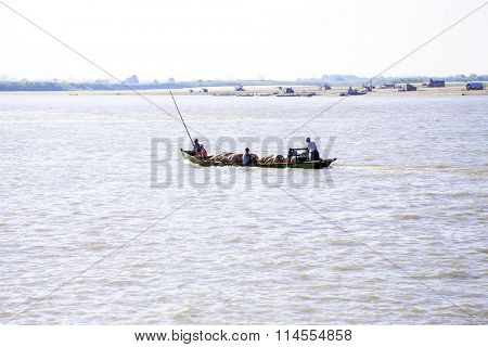 IRRAWADY RIVER, MYANMAR - November 17, 2015: Transporting pigs on the Irrawaddy River. The Irrawady river r is a river that flows from north to south through Myanmar and is the most important waterway