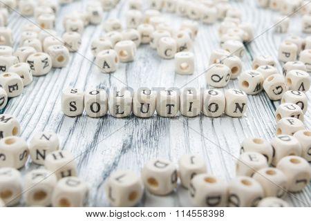 Solution word written on wood block.
