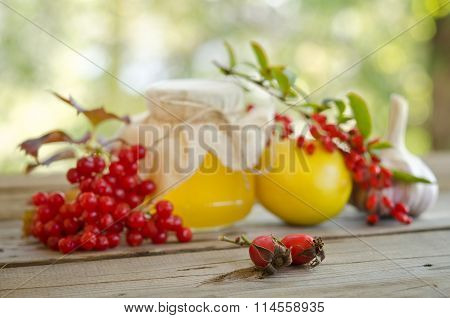 Honey And Others Natural Medicine For Winter Flue, On Wooden Table