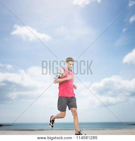 Fit man running against beach