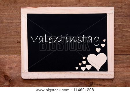 Blackboard With Wooden Hearts, Text Valentinstag Means Valentines Day