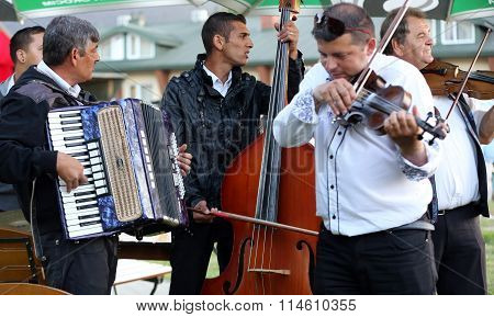 REGIETOW POLAND - JULY 11 2015: Gipsy music group playing live music in Regietow. Poland