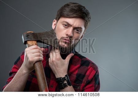Attractive strong young man with strange axe