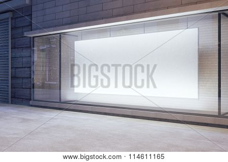 Large Blank Banner In A Shop Window At Night, Mock Up