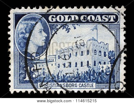 GHANA - CIRCA 1957: A stamp printed in Ghana shows Christiansborg Castle and queen Elizabeth II, circa 1957