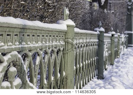 the cast iron railings of the bridge Saint-Petersburg Russia winter photos