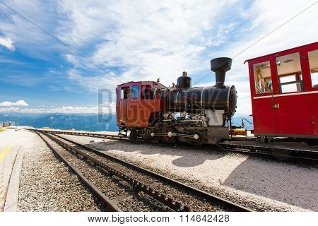 Steam Train In A Beautiful Alpine Landscape.