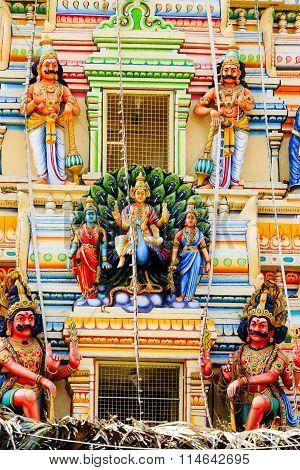 Lord Subrahmanya, Goddess Valli and Devayani on the Gopuram of Ghati Subramanya temple