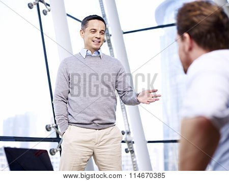 Corporate Business People Chatting In Office