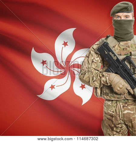 Soldier Holding Machine Gun With Flag On Background Series - Hong Kong