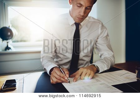 Executive Male Working At Desk