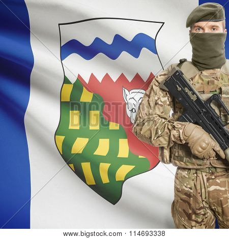 Soldier with machine-gun in hands and Canadian province flag on background series - Northwest Territories poster