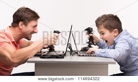 Father and son playing the computer games