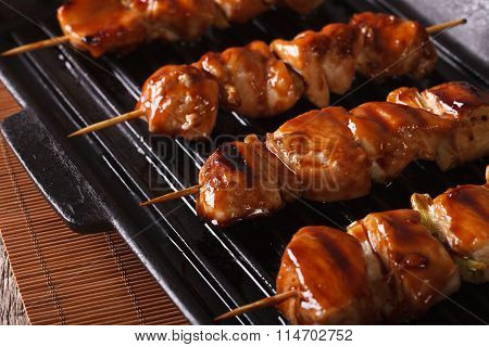 Japanese Yakitori Skewers Of Chicken On A Grill. Horizontal Close-up