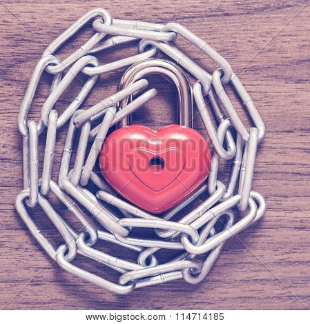 Lock heart with chain.