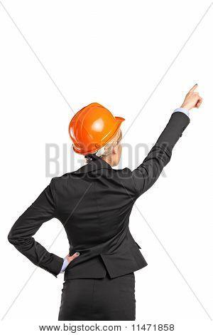 A Forewoman In Black Suit Pointing