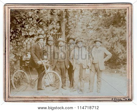 Vintage photo shows men in nature. Photo was taken in Austro-Hungarian Empire on September 15 1909.