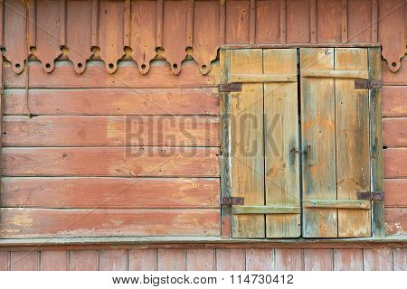 Exterior of the abandoned wooden building wall with closed window in Trakai, Lithuania.