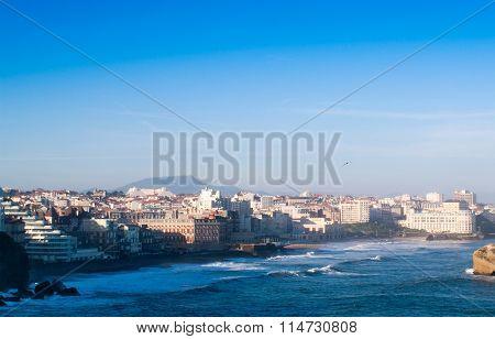 ocean and city, blue sky
