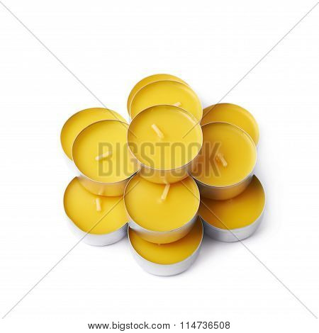 Pile of tealight paraffin wax yellow candles isolated over the white background poster