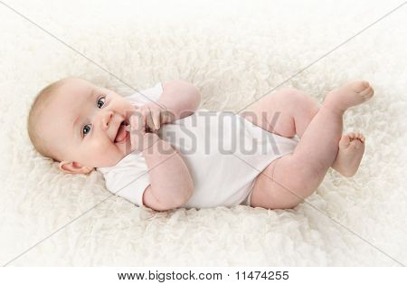 Baby Lying On Back Smiling