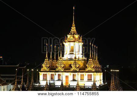 Loha Prasat Metal Palace At Night In Bangkok, Thailand.