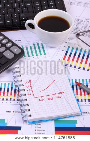 Pen, Glasses, Computer Keyboard And Cup Of Coffee On Financial Graph, Business Concept