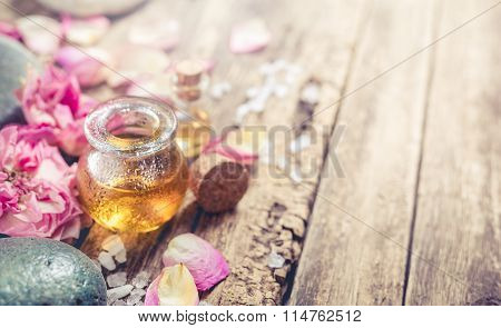 Massage Oil, Petals Flowers And Zen Stones.