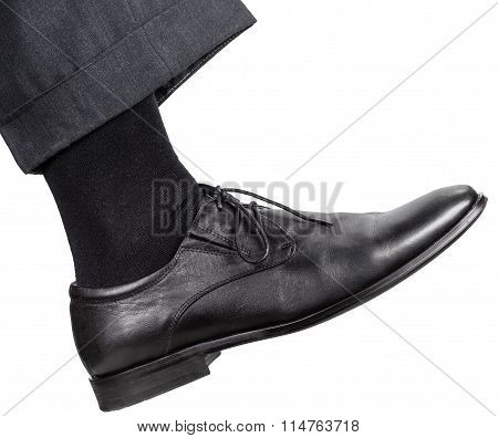 Male Right Leg In Black Shoe Takes A Step