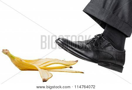 Foot In The Left Black Shoe Slips On A Banana Peel