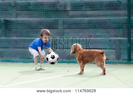 Cute Little Boy, Playing Football With His Dog