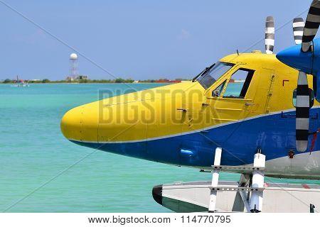 Seaplane Landing On Turquoise Water
