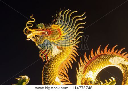 Chinese Style Dragon Statue Dragon At Night, In Thailand.