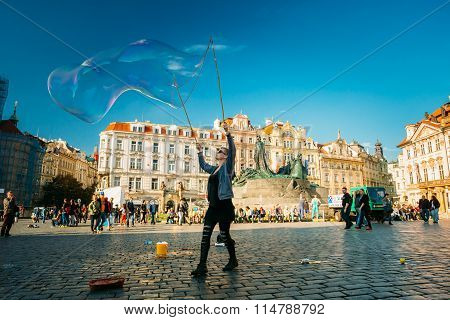Unidentified woman makes soap bubbles in Old Town Square in Prague, Czech Republic