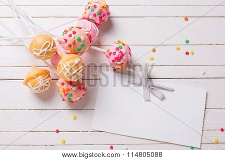 Cake Pops  And Empty Tag On White Wooden Background.