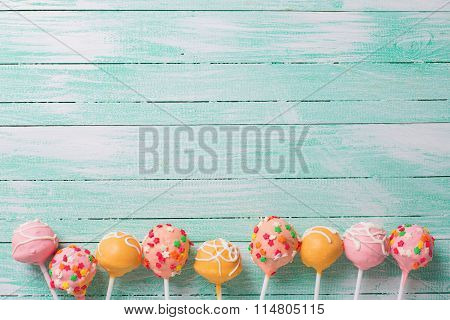 Cake Pops On Turquoise  Painted Wooden Background.