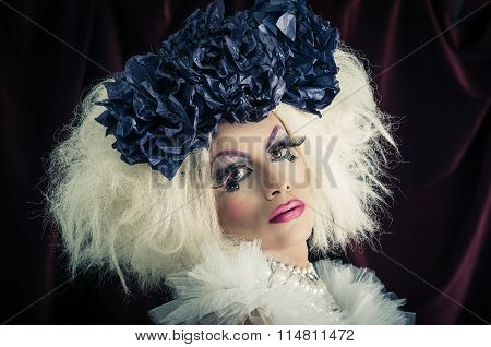 Drag queen with spectacular makeup, glamorous trashy look, posing happily and charming camera. poster