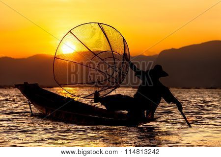 Sunset and fisherman on Inle Lake
