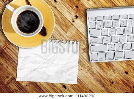 Blank Paper On Wood Table With Computer Keyboard
