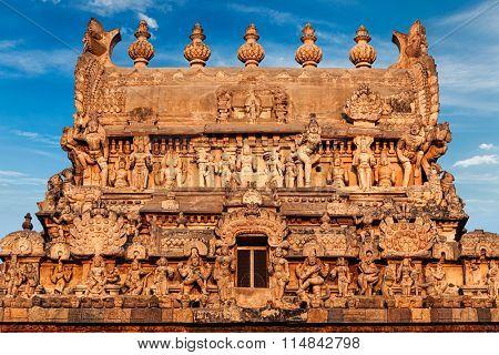 Entrance tower (gopura) of Periyanayaki Amman Temple against sky. Airavatesvara Temple, Darasuram, Tamil Nadu, India