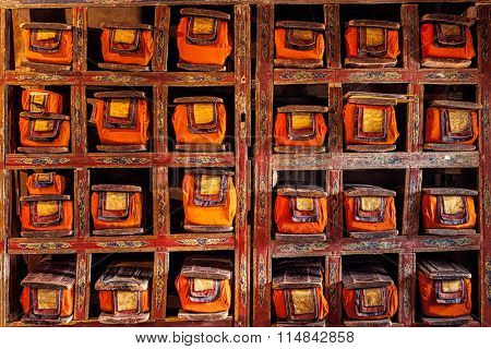 Folios of old manuscripts in library of Thiksey Gompa (Tibetan Buddhist Monastery). Ladakh, India