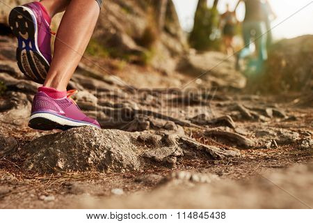 Athlete's Sports Shoes On A Dirt Track.