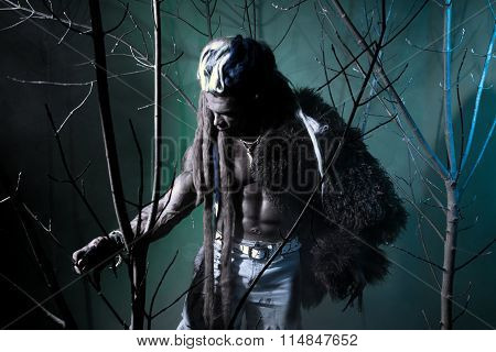 Muscular Werewolf Among The Branches Of The Tree