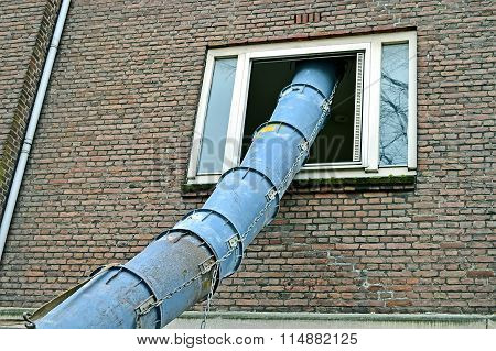 Big Industrial Pipe Into Window Hole, Modern Construction