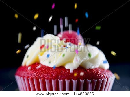 Multicolor Candy Topping Pouring On Strawberry Delicious Cupcake Muffin In Sugar Temptation Concept