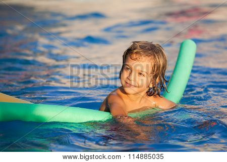 Happy Child Learning To Swim